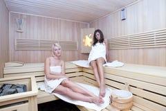 Two women in sauna stock photos