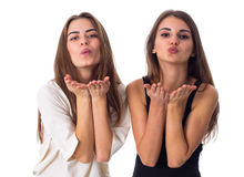 Two women sending air kisses Stock Photos