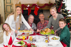 Two women serving christmas dinner to their family Royalty Free Stock Photos
