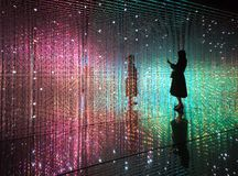 A woman takes a selfie at the Team Lab moving exhibit in Shenzhen China Royalty Free Stock Photography