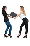 Two women share a folder Royalty Free Stock Photo