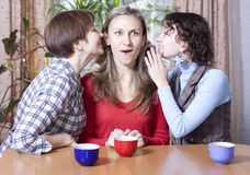 Two women share secrets with a friend Royalty Free Stock Photo