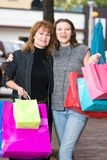 Two Women Shopping. Mother and daughter on a shopping trip together in the city Stock Images