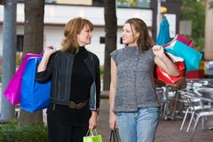 Two Women Shopping. Mother and daughter on a shopping trip together in the city Royalty Free Stock Photos