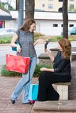 Two Women Shopping. Mother and daughter on a shopping trip together in the city Stock Photo