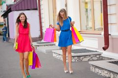 Two women with shopping bags Stock Photos
