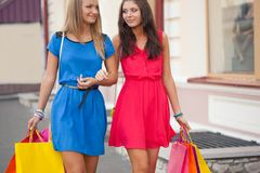 Two women with shopping bags Royalty Free Stock Photography