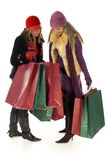 Two women with shopping bags Royalty Free Stock Images
