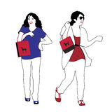 Two women with shopping bags Stock Photography