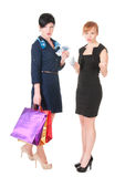Two women with shopping bags holding money Stock Photography