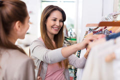 Two women shopping in a boutique Stock Photos