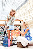 Two women in a shopping center Royalty Free Stock Image