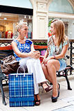 Two women in a shopping center Royalty Free Stock Images