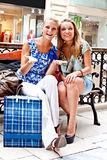 Two women in a shopping center Royalty Free Stock Photos