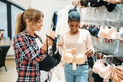 Two women shopping, lingerie department stock photo