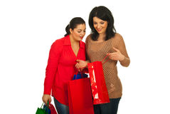 Two women at shopping looking bag. Two women at shopping checking inside  bag  isolated on white background Stock Photo