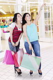 Two women shopping in modern mall Royalty Free Stock Photo