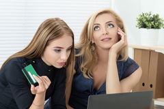 Two women shopping online Royalty Free Stock Photos