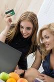 Two women shopping online Stock Photos