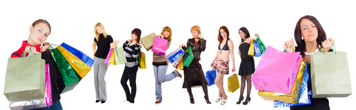 Two women shopping and six other at the background Stock Images