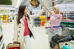 Two women shopping in supermarket Royalty Free Stock Image