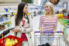 Two women shopping in supermarket Royalty Free Stock Photo