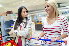 Two women shopping in supermarket Stock Image