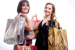 Two women shopping in a white background. Stock Photo