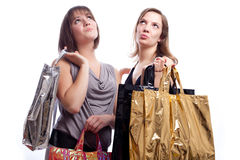 Two women shopping in a white background. Shopping: two woman shopping in a white background Royalty Free Stock Photos