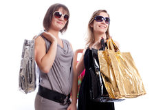 Two women shopping in a white background. Shopper: Two women shopping in a white background Royalty Free Stock Photography