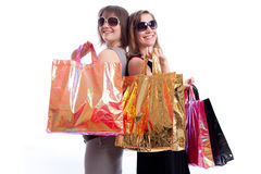 Two women shopping in a white background. Shopper: Two women shopping in a white background Stock Image