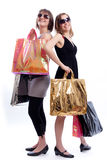 Two women shopping in a white background. Shopper: Two women shopping in a white background Stock Photography