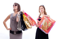 Two women shopping in a white background. Shopper: women with shopping bags in a white background Stock Photos