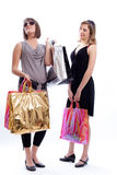 Two women shopping in a white background. Shopper: women with shopping bags in a white background Royalty Free Stock Photography