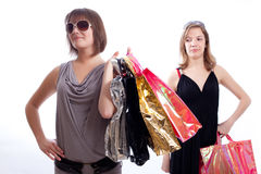 Two women shopping in a white background. Shopper: Two women with shopping's bags in a white background Royalty Free Stock Images