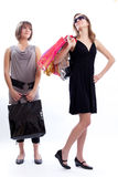 Two women shopping in a white background. Royalty Free Stock Photo
