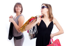 Two women shopping in a white background. Shopper: Two women with shopping's bags in a white background Stock Photo