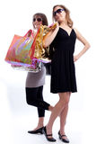 Two women shopping in a white background. Stock Photography