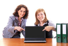 Two women showing display of notebook Stock Photo
