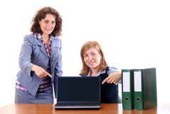 Two women showing display of notebook Royalty Free Stock Image