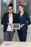 Two women are showing a tablet Stock Images