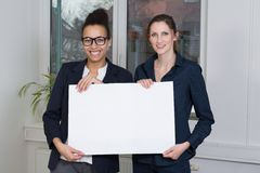 Two women are showing a whiteboard Royalty Free Stock Image