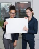 Two women are showing a whiteboard Stock Photo