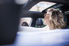 Two women singing in the car. Young and beautiful women singing and dancing to the rhythm of music in their car stock photos