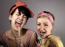 Two women singing together. Karaoke, retro style stock photo