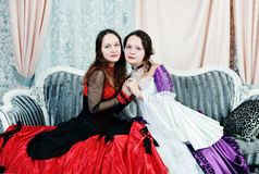 Two women sisters in medieval dresses Royalty Free Stock Photo
