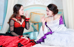 Two women sisters in medieval dresses Stock Photos