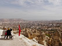 Top view of Cappadocia. two women sit on top and look at the city stock photo