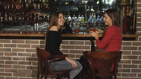 Two women sitting at the bar,have fun smile stock video