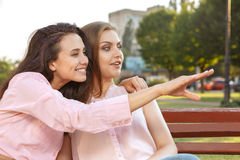 Two women sitting on the bench Royalty Free Stock Photography